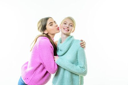 knitted wear fashion. happy girls in knitted wear. sweater weather. warm clothes. knit. cashmere. friendship and family. happy to be together. handmade and diy. knitwear collection. kiss