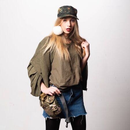 camping and hiking concept. woman in cap with water bottle. Beauty and fashion. Sensual woman. makeup and hair style. trendy look. Sexy girl. adventure fashion wear. military style. military Banco de Imagens