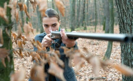military fashion. gun barrel. achievements of goals. girl with rifle. chase hunting. Gun shop. female hunter in forest. successful hunt. hunting sport. woman with weapon. Target shot. Hobby