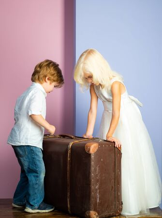 Boy and girl cute friends. Friendship and love. Lovely tender children. Small kids friendship. Sincere friendship. We are moving on. Relocation concept. Couple kids with suitcase. Happy childhood Stockfoto