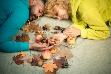 Funny couple are getting ready for autumn sale. Autumn couple wearing in autumn clothes and looks very sensually. Couple in Love wearing in fashionable seasonal clothes having Autumnal mood.