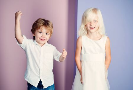 Happy childhood. International childrens day. Boy and girl cute friends. Friendship and love. Lovely tender children. Small kids friendship. Sincere friendship. Couple adorable kids white clothes Stockfoto