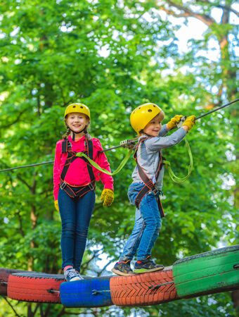Helmet and safety equipment. Eco Resort Activities. Artworks depict games at eco resort which includes flying fox or spider net. Children summer activities.