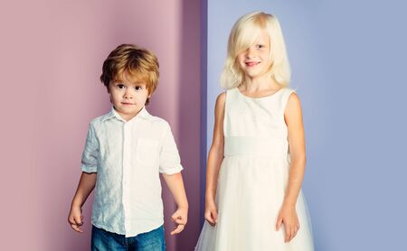 Couple adorable kids white clothes. Happy childhood. International childrens day. Boy and girl cute friends. Friendship and love. Lovely tender children. Small kids friendship. Sincere friendship Stok Fotoğraf