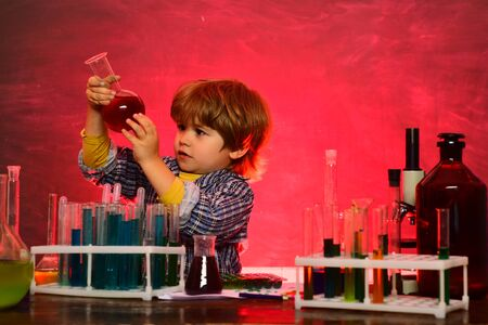A chemistry demonstration. Learning at home. Lab microscope and testing tubes. What is taught in chemistry. Elementary school. Ready for school. Home schooling