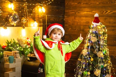 Make wish. Best wishes for you your family this christmas. Merry christmas and happy new year. Cute boy play near christmas tree. Kid enjoy winter holiday at home. Home filled with joy and love 스톡 콘텐츠