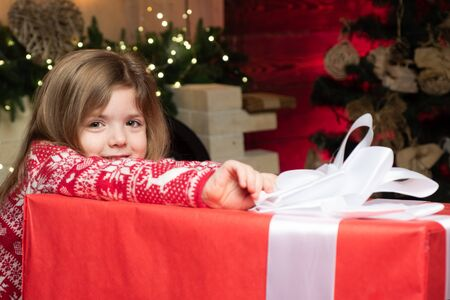 Cozy christmas atmosphere. Girl baby christmas eve. Merry christmas and happy new year. Cute little child girl play near christmas tree. Kid enjoy winter holiday at home. Home filled joy and love 版權商用圖片