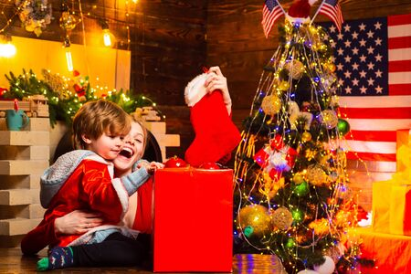 Family having fun at home christmas tree. Family holiday. Happy family. Mom and kid play together christmas eve. Mother and little child boy adorable friendly family having fun. My dear baby santa