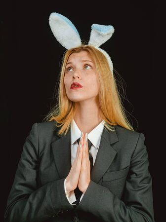 Sweet lovely attractive adorable charming cheerful positive girl in bunny ears celebrating Easter. Happy easter. Sexy woman wearing a black Easter Bunny. Stock Photo