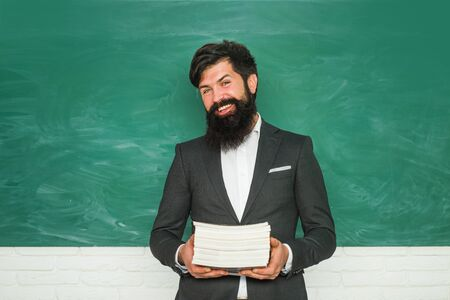 Teachers day - knowledge and educational school concept. Serious male Student studying in school. School concept.