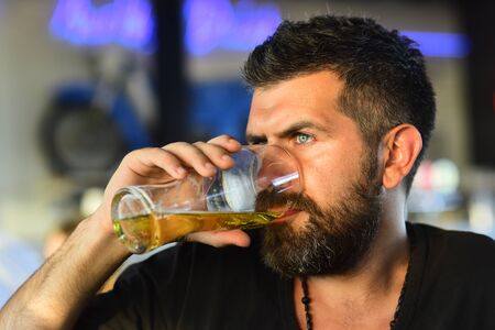 Senior man drinking beer with surprise face. Handsome bearded man drinking beer.