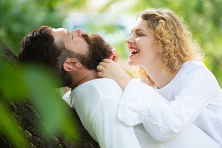 Passionate horny woman with lover feeling pleasure having sex. Handsome young man seducing his lovely girlfriend. Sensual touch. Couple in love. Stock Photo