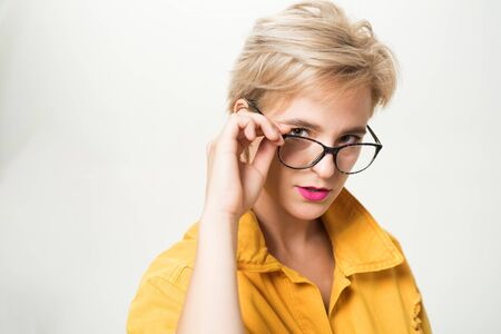 Woman adorable blonde wear eyeglasses close up. Eyewear fashion. Add smart accessory. Stylish girl with eyeglasses. Eyesight and eye health. Good vision. High quality lens. Fashionable eyeglasses Stock Photo