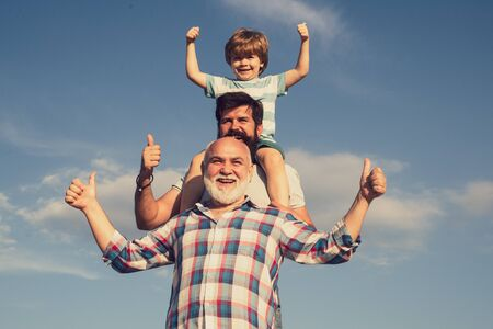 Men generation. Father and son with grandfather - happy loving family. Cute child hugging his father and grandfather. Happy man family have fun together. 스톡 콘텐츠