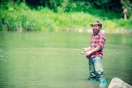 American angler fishing. Man fishing. Fly fishing in the pristine wilderness of Russia.