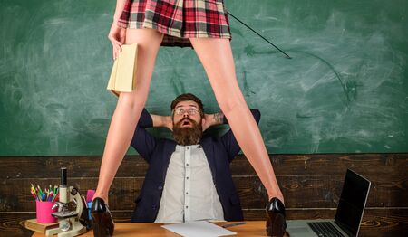Sex education. Sex role game. Man bearded teacher and female mini skirt legs. Learning female body. Domination and submission. Desirable student with whip high heels stand on table