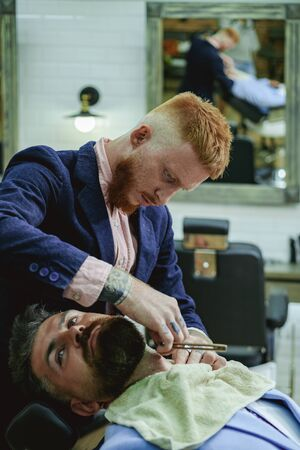 Trims. Beard balm. Beard care. Hair style and hair stylist. Fine Cuts. Professional hairstylist in barbershop interior. Hair Preparation is just for the dashing chap. Razor blade. Banco de Imagens