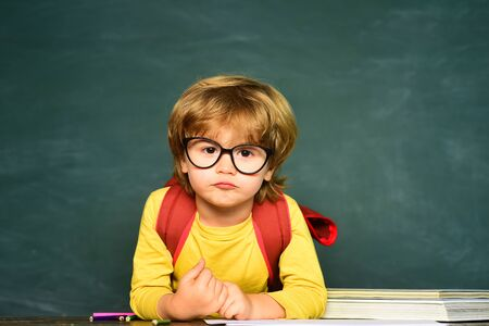 Blackboard copy space. School lessons. Little boy getting bullied in school. School bullying.
