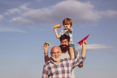 Men generation. Father and son with grandfather - happy loving family. Generation of people and stages of growing up. Father and son enjoying outdoor. Family people. Leisure activity.