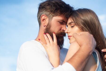 Intimacy and tenderness in love. Intimate moments for happy lovers. Young lovers couple. Happy couple in love having fun. Sensual kiss. Sensual couple getting closer to feel each others lips.