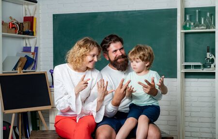 Cheerful family playing with set for creativity. Teachers day. School family. Home Family math schooling - Parents teaching kids private lessons in math.