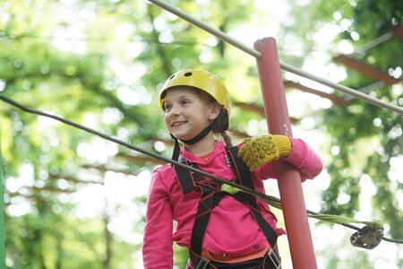 Artworks depict games at eco resort which includes flying fox or spider net. Toddler age. Children summer activities. Go Ape Adventure. Stock Photo
