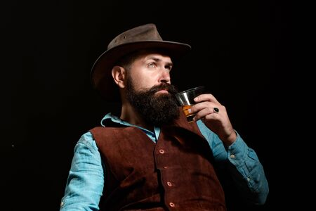 Addicting to alcoholic drink. Humans struggling with her bad habits. Alcohol addiction dangerous. Man with beard holds glass brandy.