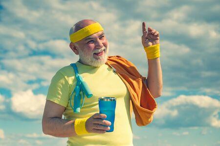 Healthcare cheerful lifestyle. Energetic for senior sportsmen. Senior man in health club. Grandfather pensioner. Senior man workout in rehabilitation center. Sport and retirement concept. Reklamní fotografie