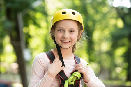 Go Ape Adventure. Happy Little girl climbing on a rope playground outdoor. Little girl concept. High ropes walk. Early childhood development. Children fun. 版權商用圖片