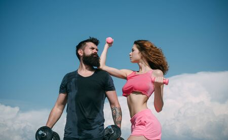 healthy lifestyle. dieting. freedom. sporty couple training outdoor. perfect body muscle. dumbbell lifting. sport and fitness. summer activity. barbell equipment. bearded man and woman with fit belly
