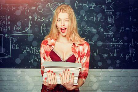 Back to, school. Young sensual student near chalkboard in school classroom. Tutor. First school day. First school day. Emotional sensual woman student screaming on classroom chalkboard background.