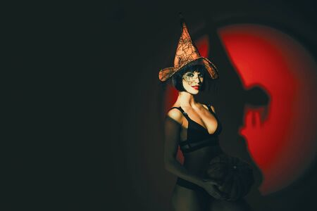 Halloween woman design. Sexy stripper Woman with pumpkins. Halloween lingerie model. Vampire girls. Sunsual desire concept. Imagens