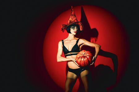 Halloween woman design. Woman with pumpkins. vampire girls. Sunsual desire concept. Halloween lingerie model. Imagens