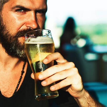 Man with beer. Retro man with a beer. Beer pubs and bars. Pub is relaxing place to have drink and relax. Stock Photo