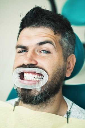Cute man smiling looking camera. Portrait of cheerful male person with snow white teeth. Senior man having dental treatment at dentists office. Professionalism service medicine healthcare concept.