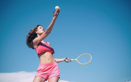 Girl with athletic body playing tennis. Happy active female workout. Beautiful attractive fitness woman. Sporty young woman. Tennis concept.