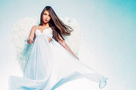 Young woman in angel costume. Valentines day and costumes concept. Cupid woman. Valentines Day concept.