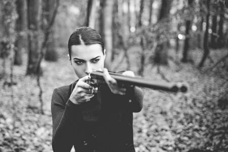 Hunter woman. Hunting in forest. Portrait of woman Hunter. Closed and open hunting season. Autumn hunting season. Hunting.