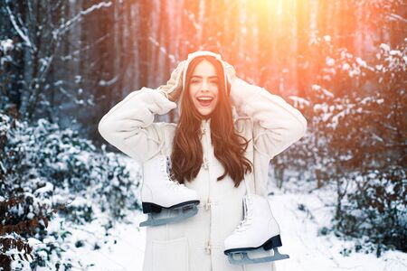 Christmas winter girl outdoor portrait. Young woman winter portrait. Snowing winter beauty fashion concept. Winter woman.