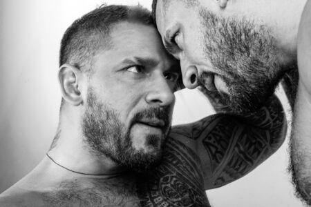 Closeup portrait of handsome male models. Relationship.
