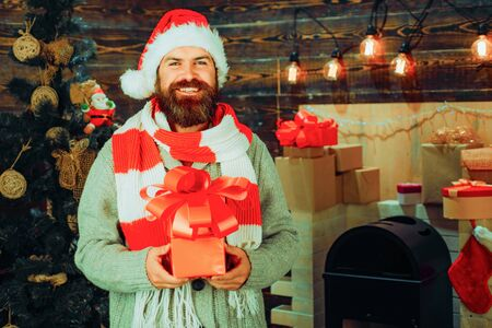 Modern santa wishes Merry christmas and Happy new year. Santa claus with Christmas gifts.