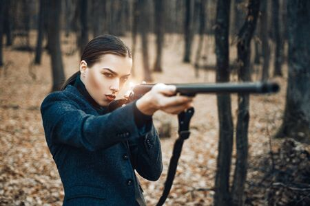 Military fashion. achievements of goals. girl with rifle. chase hunting. Gun shop. woman with weapon. Target shot. female hunter in forest. successful hunt. hunting sport