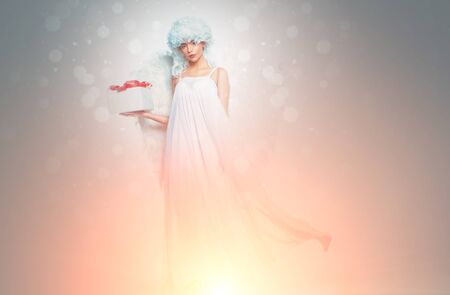 Valentines Day symbol. Angel woman with wings isolated. Art photo of a Angelic beautiful woman. Stock fotó