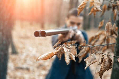 Gun shop. military fashion. achievements of goals. successful hunt. hunting sport. woman with weapon. Target shot. hunter in forest