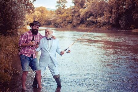 Fly fishing is most renowned as a method for catching trout grayling and salmon. Fly fisherman using fly fishing rod in beautiful river. Man fisherman catches a fish.