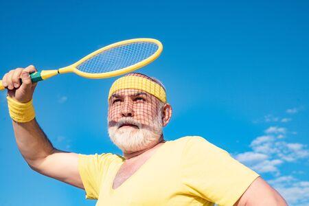 Senior man playing Badminton. Be in motion. Grandfather sportsman. Stok Fotoğraf