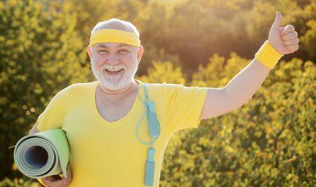 Portrait of healthy senior sport man. Grandfather sportsman. Senior man in health club. Fit senior man resting after working out. Reklamní fotografie - 128604764