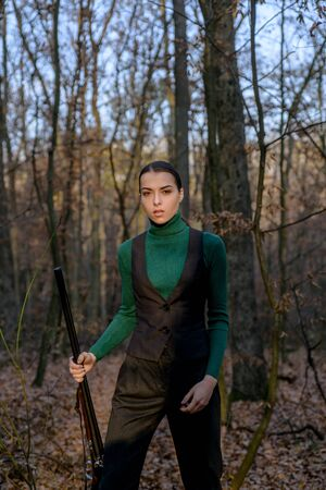 hunter at dawn. female hunter in forest. girl with rifle. chase hunting. Gun shop. successful hunt. hunting sport. military fashion. achievements of goals. woman with weapon. Target shot