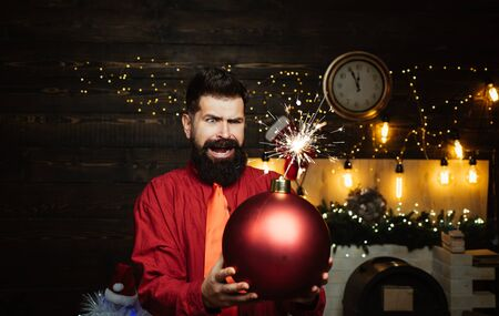 Funny Santa wishes Merry Christmas and Happy new year. Funny Santa Claus. Happy Santa claus. Creative boom. Christmas party. Stock Photo