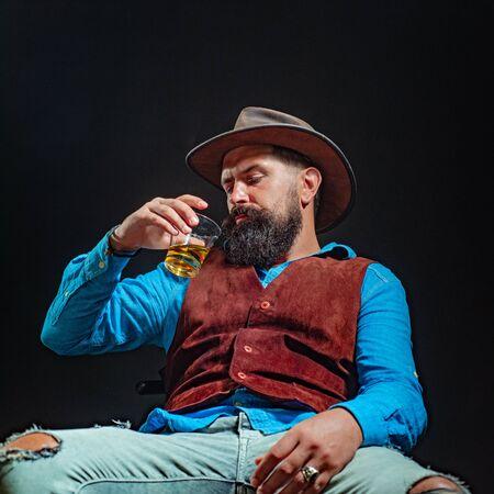 Man with beard holds glass brandy. Bad habit - alcohol addiction. Addicting to alcoholic drink. Alcohol addiction dangerous. Alcoholic addiction - get the treatment you need. 版權商用圖片